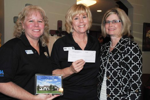 Morning Star Builders present check to HomeAid Houston
