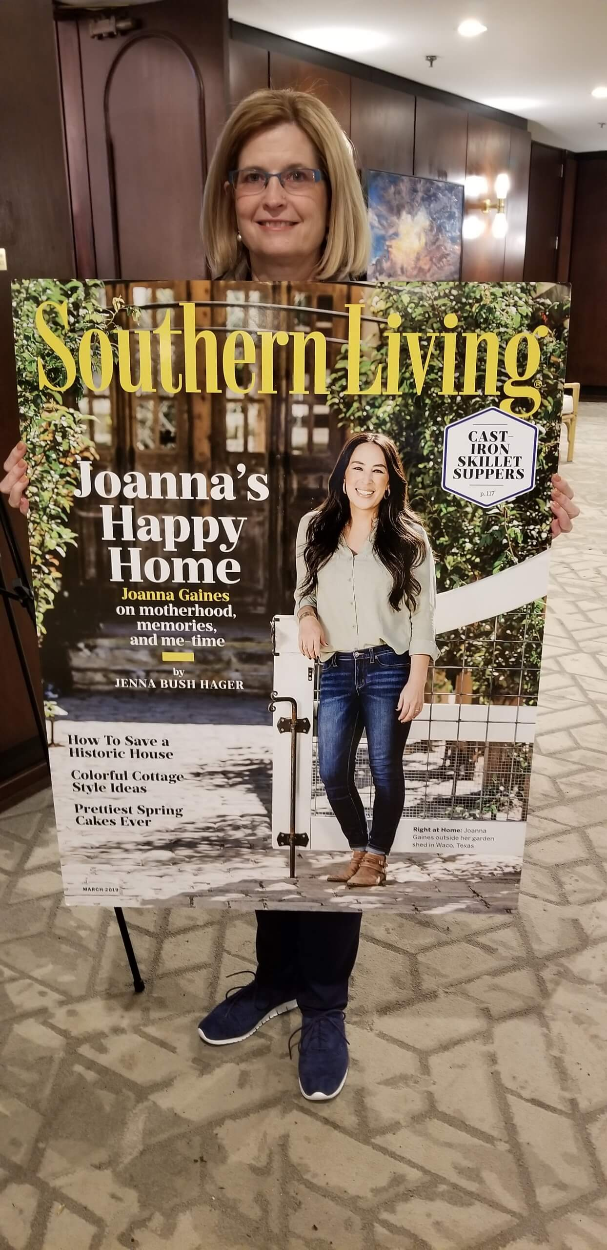 Yvonne Cummins holding front cover of Southern Living Magazine at Southern Living Builder Summit