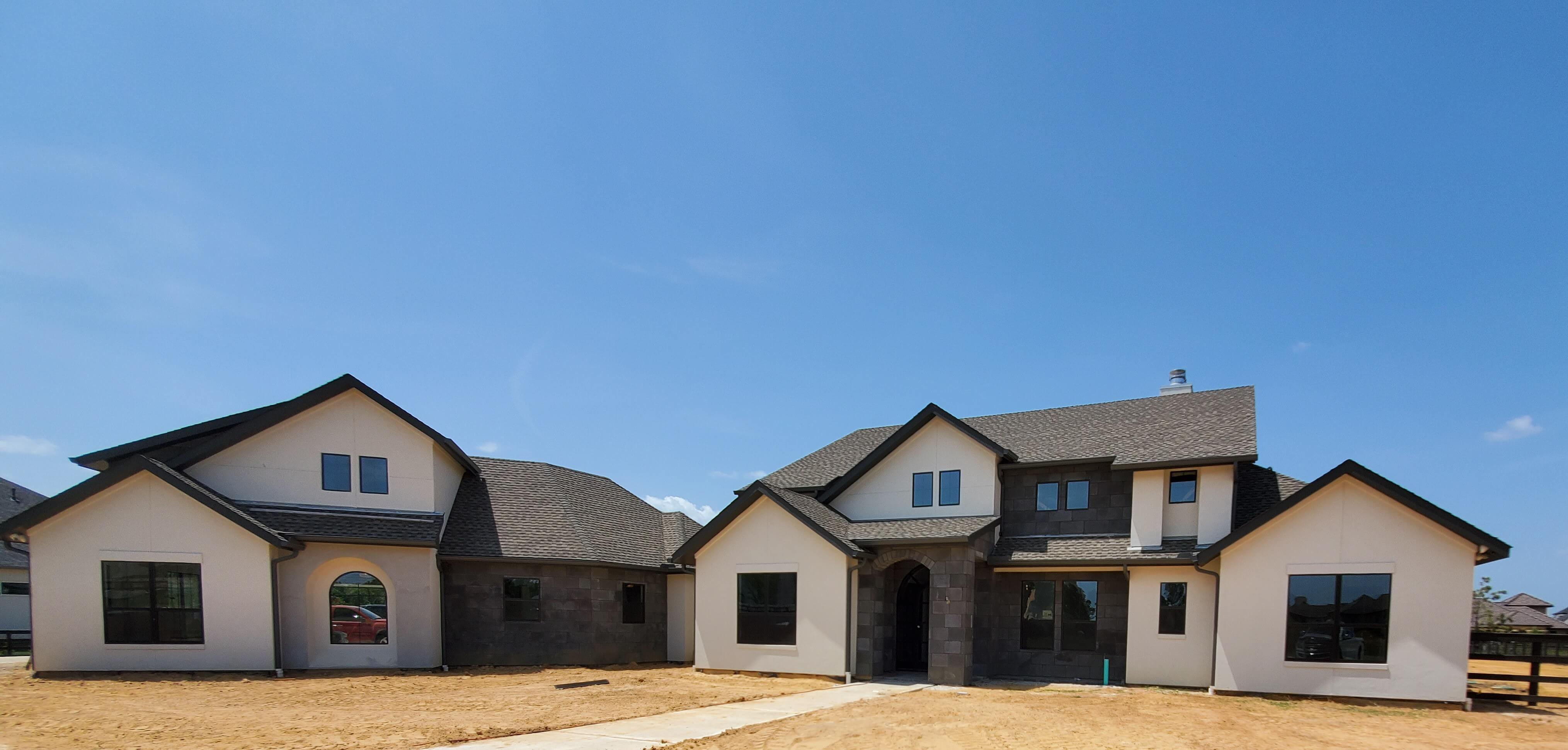 Stone and stucco home exterior with circular drive