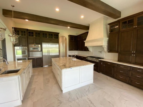 Kitchen with center island and wood beam ceiling accents
