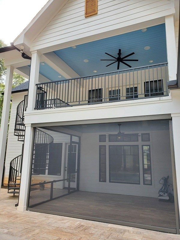 Outdoor living area with screened-in porch