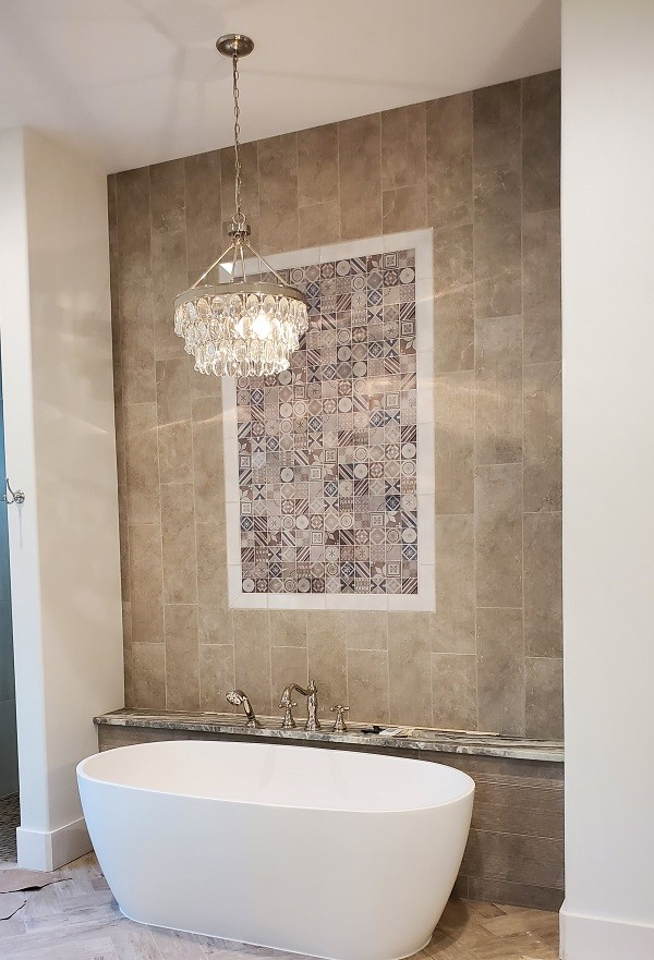 Master bathroom with soaker tub and tile feature